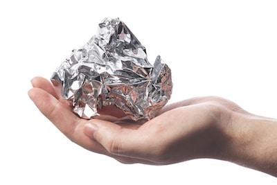 Aluminum Foil Crumpled On A Hand